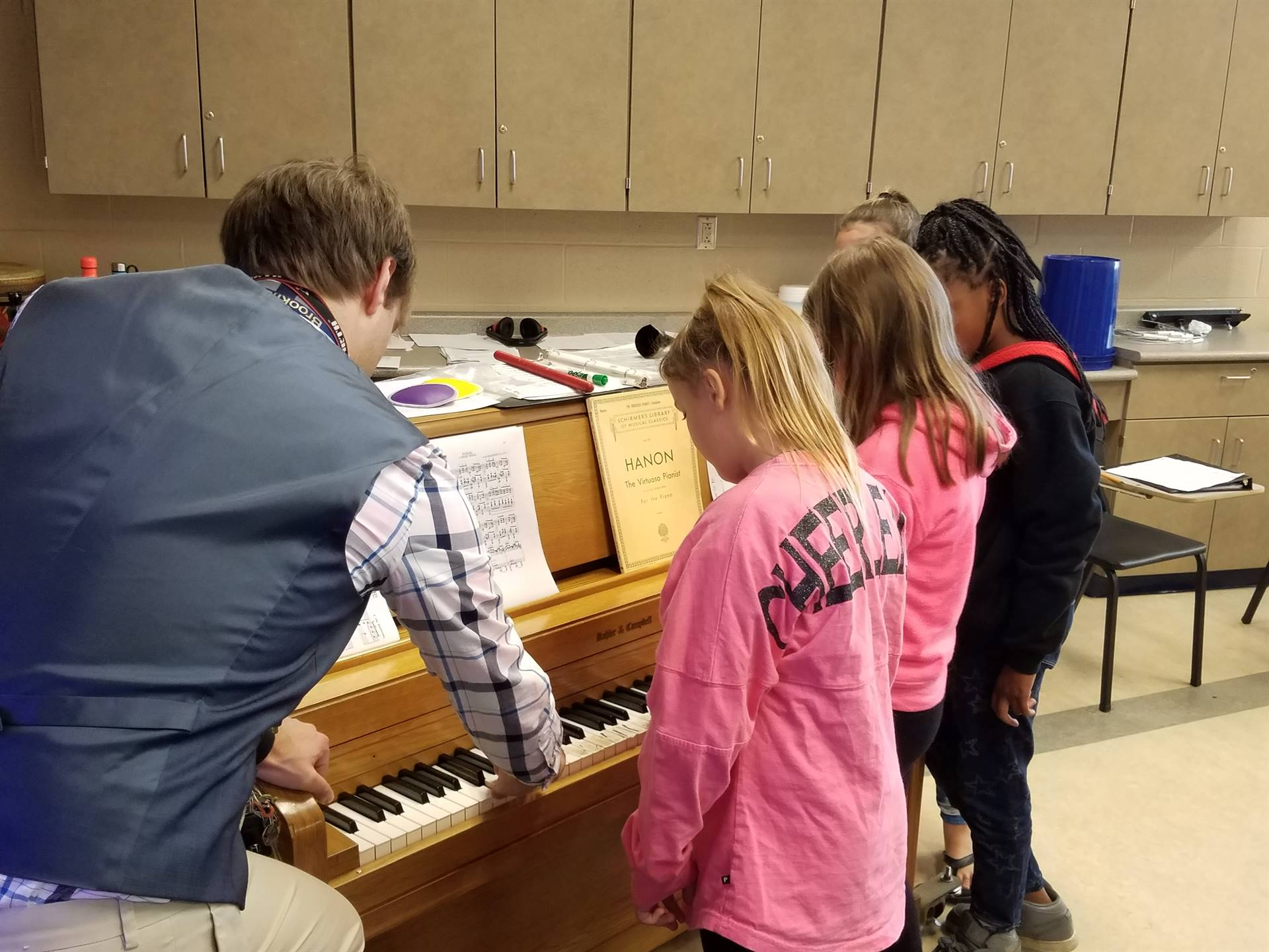 5th grade students learning to play the piano in Mr. Danch's Music Class