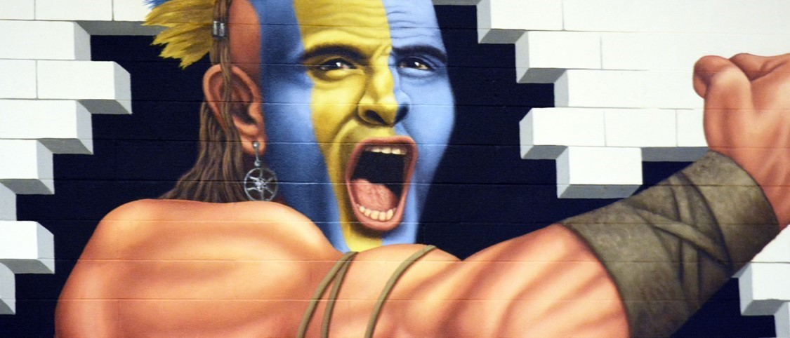 Warrior mascot mural in the High School gym