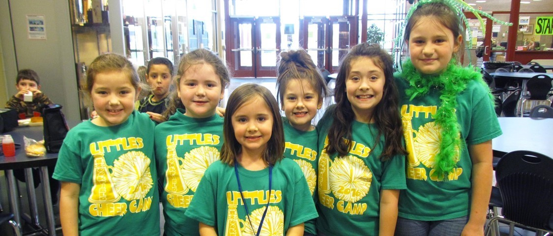 Little cheerleaders in green for Grinch Day