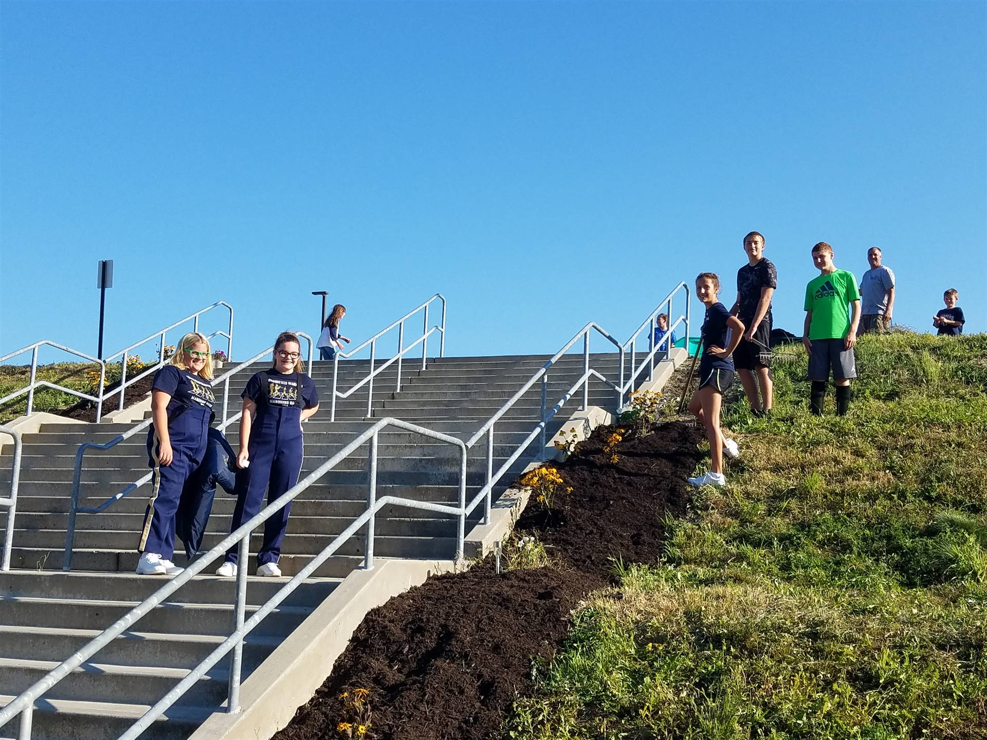 BMS Environmental Club refreshing mulch just in time for Open House