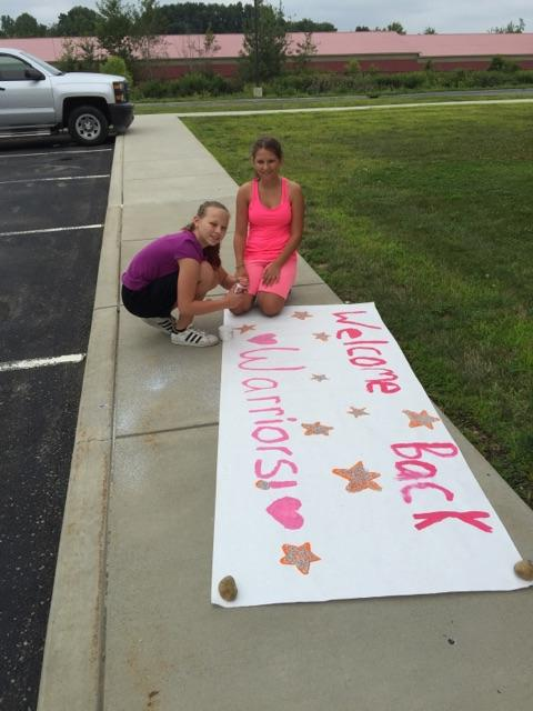 BMS Cheerleaders painting signs for our hallway