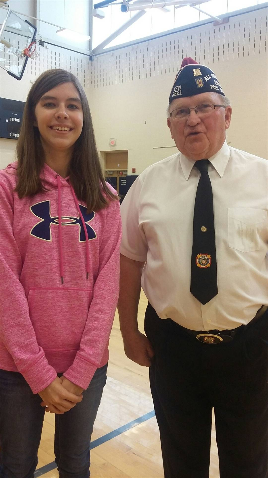 Hannah McNamara with Jeff Dreves from Vienna VFW during Memorial Day Assembly