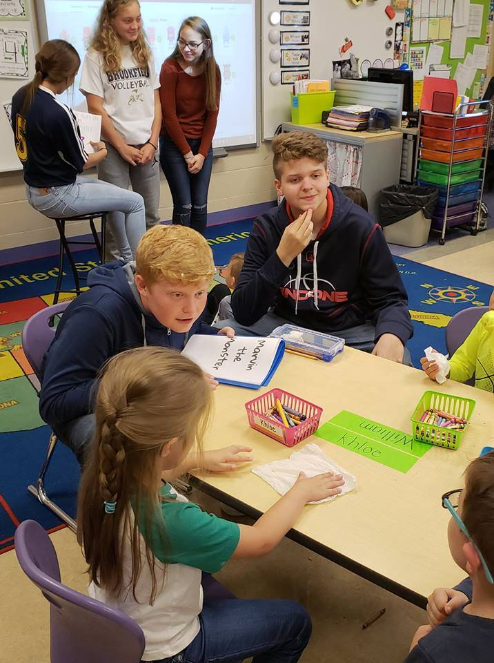 Freshman students created and read fairytales to Kindergarten students. These students were reading