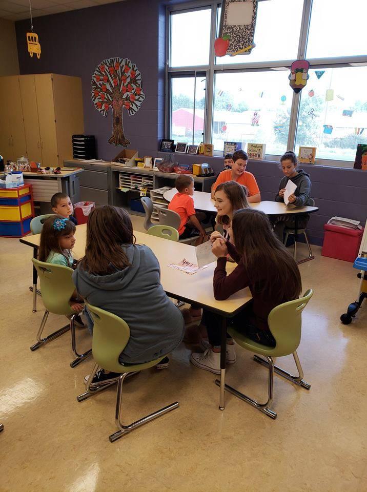 Mrs. Gardner's freshmen students reading to Miss Zebroski's Kindergarten class. Mrs. Gardner's stude
