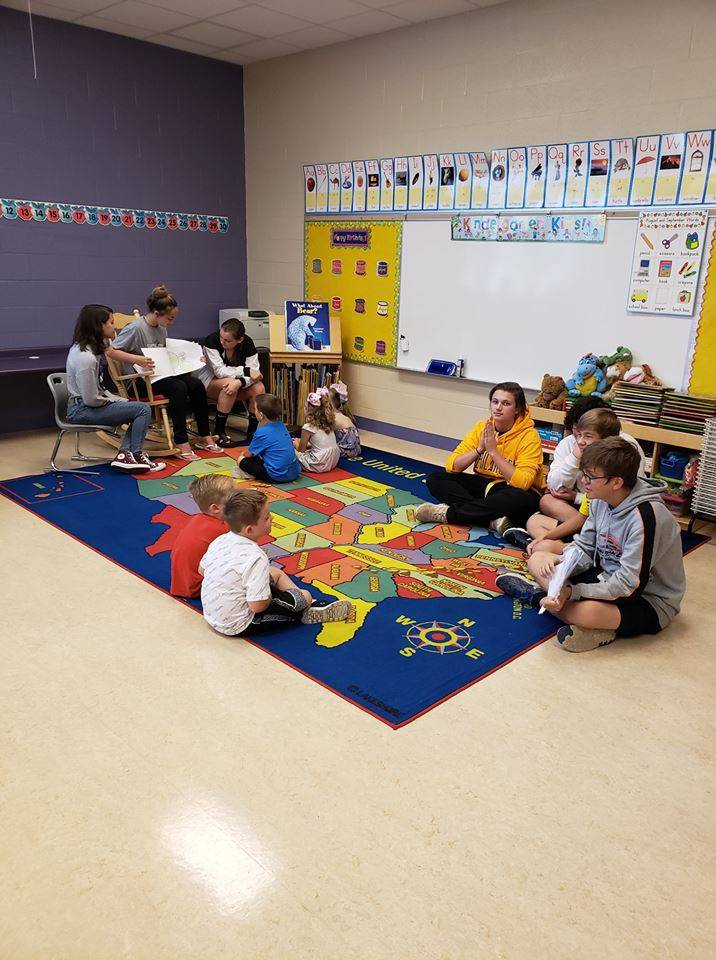Mrs. Gardner's freshmen students reading to Miss Zebroski's Kindergarten class. Mrs. Gardner's stude