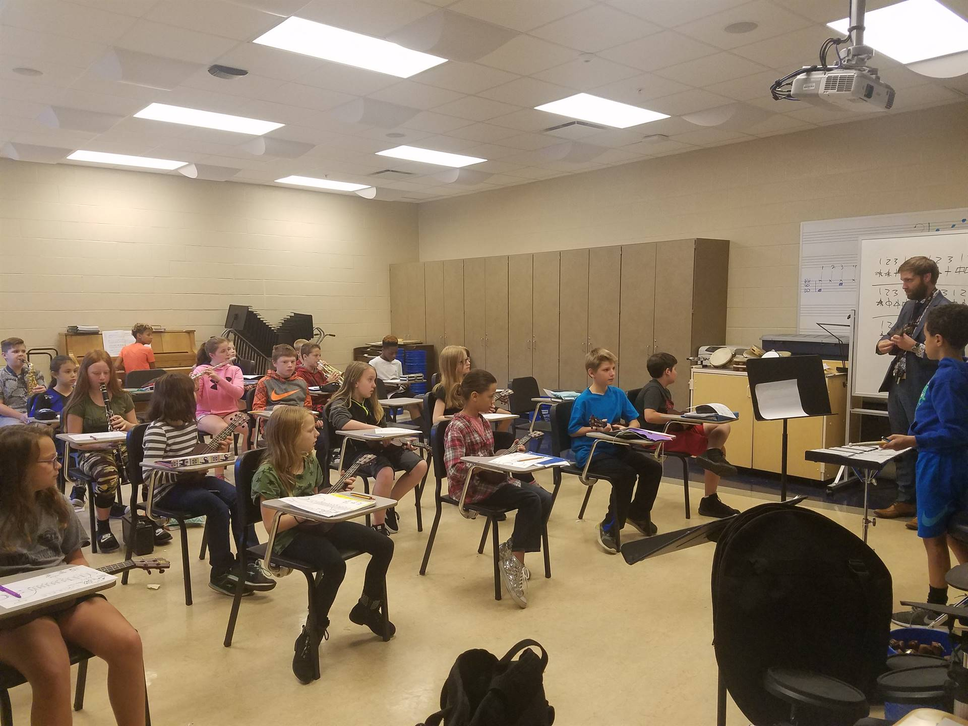 Mr. Danch's 6th Grade Music Class learning the Ukulele along with band students.