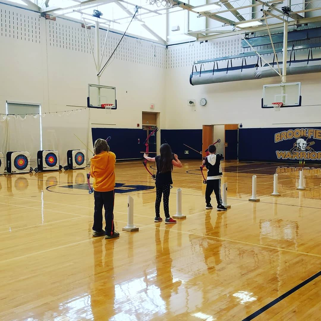 Mr. Joseph's 5th Grade Phys. Ed. practicing their Archery Skills.