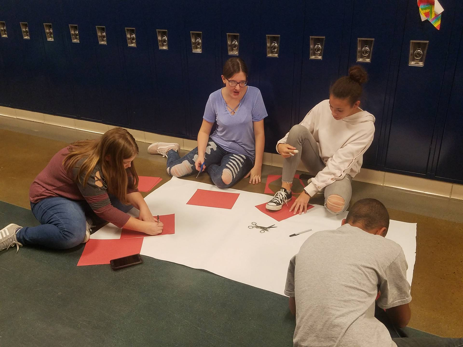"BMS SADD Members creating poster for ""Red Ribbon Week"""