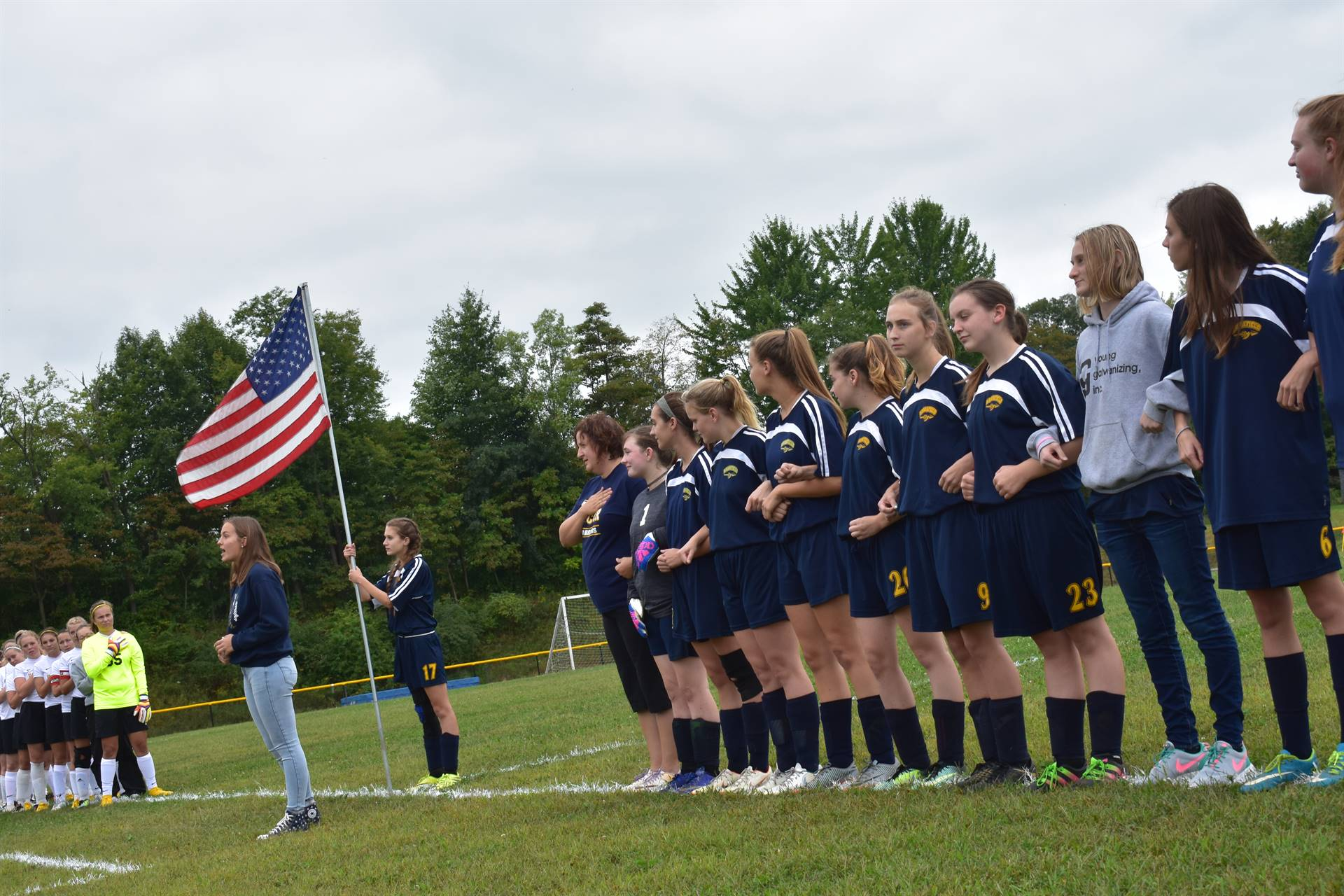 The varsity soccer team lines up prior to the game