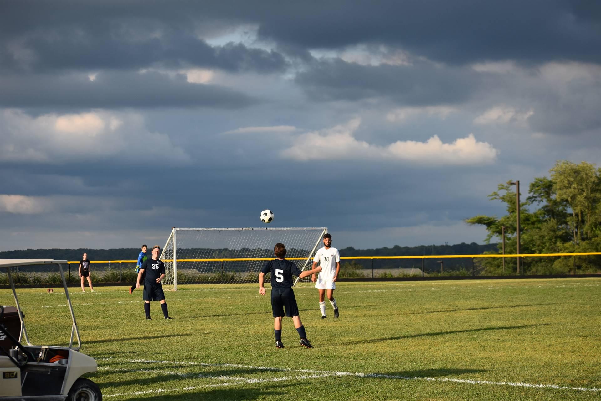 The varsity boys soccer team in action