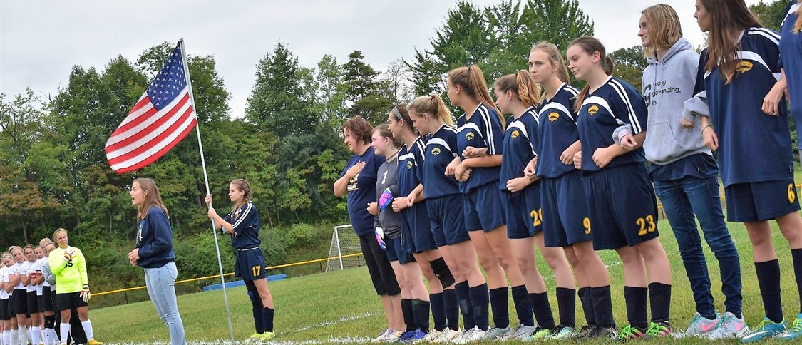girls soccer team during national anthem