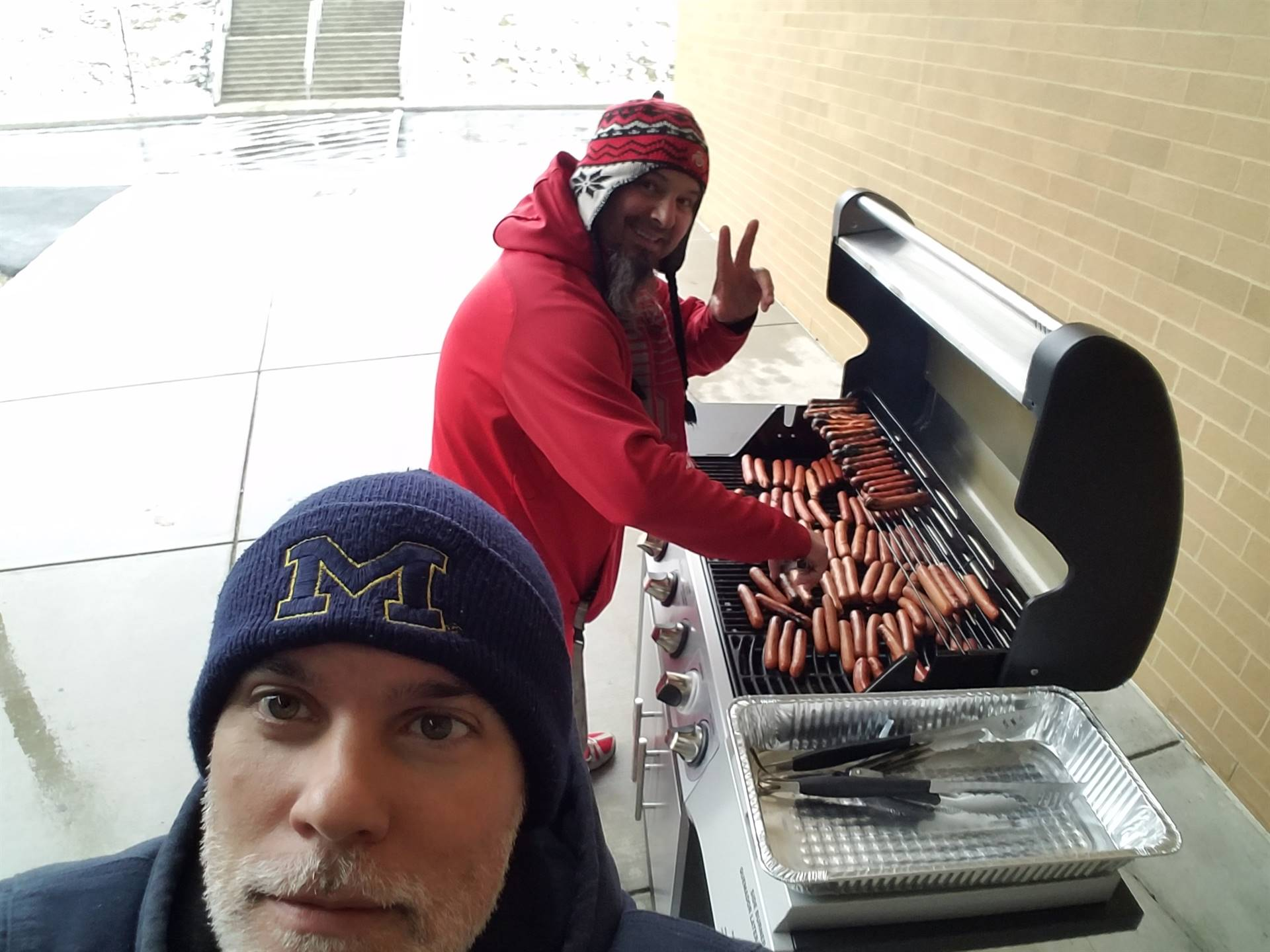 Mr. Joseph cooking hot dogs for the Michigan / OSU tailgate