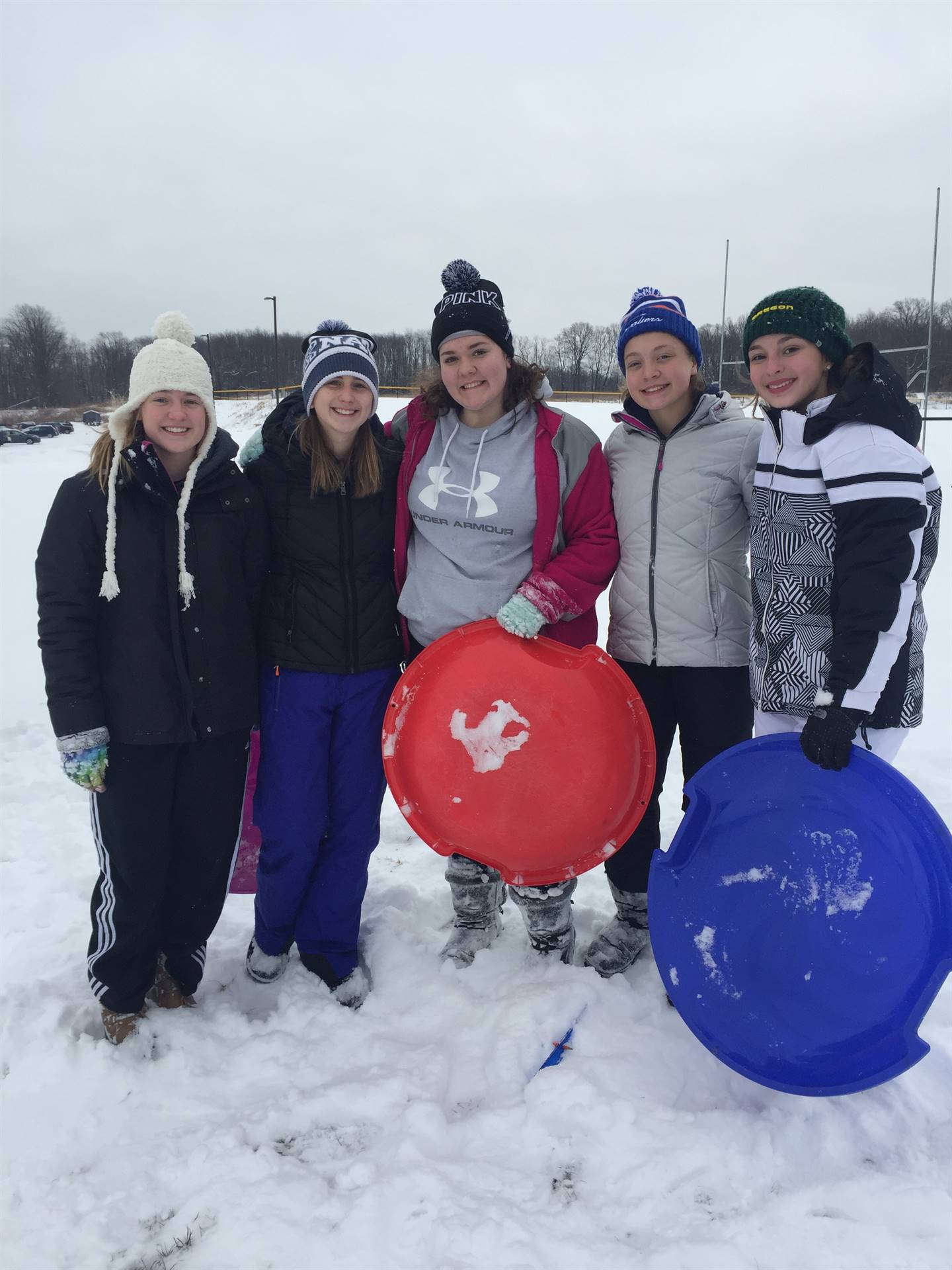 8th Grade Students enjoying our annual sled riding event.