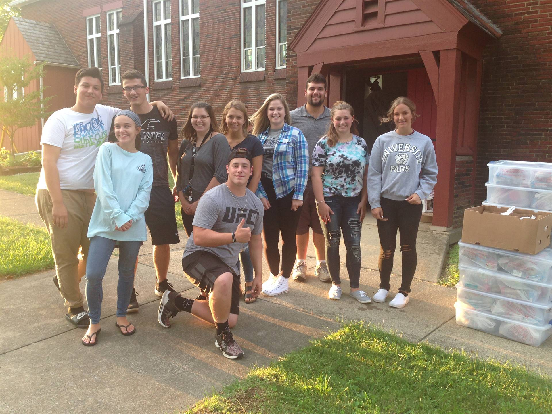 Brookfield High School Interact Club members pose outside of the Brookfield Methodist Church for a p