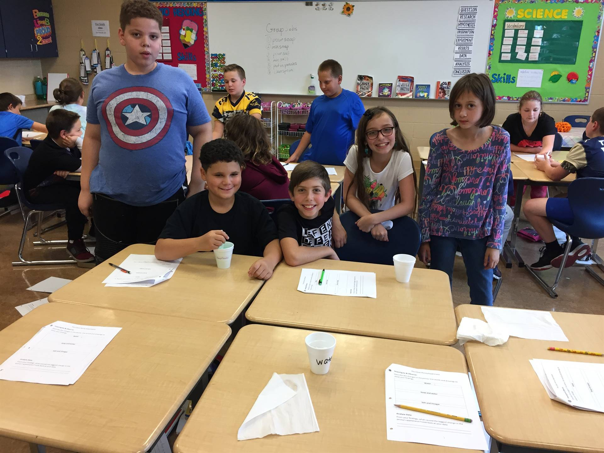 5th Grade students in Mrs. Pirigyi's Science Class conducting experiments on Pennies.