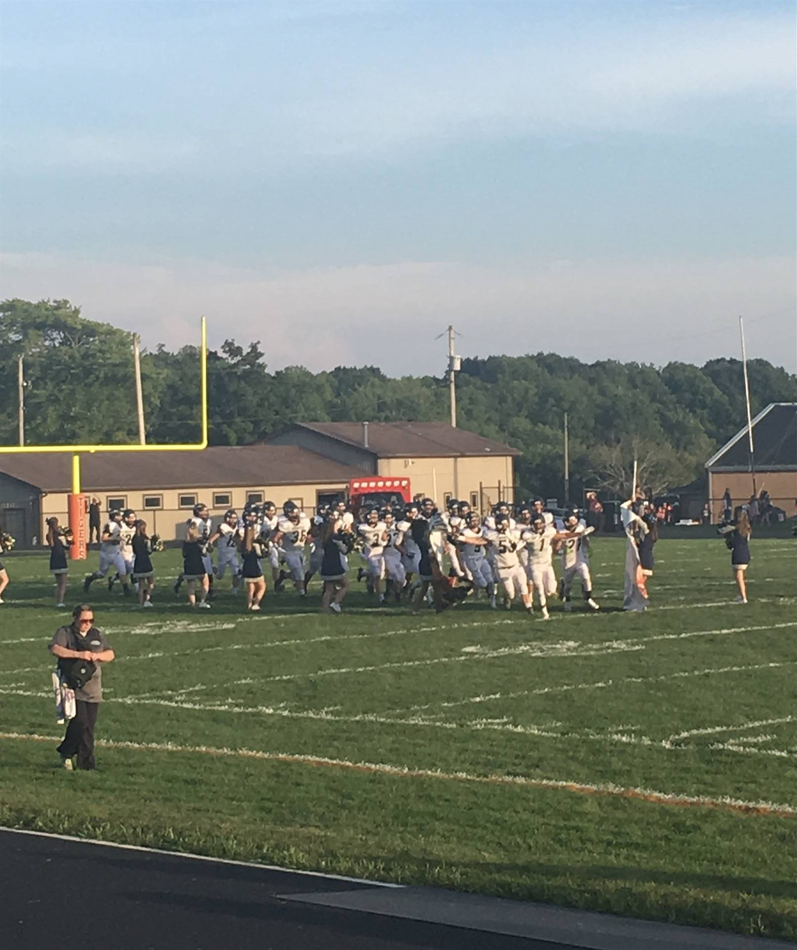 The Brookfield Warrior football team runs on to the field during their Week 2 game against the Sprin