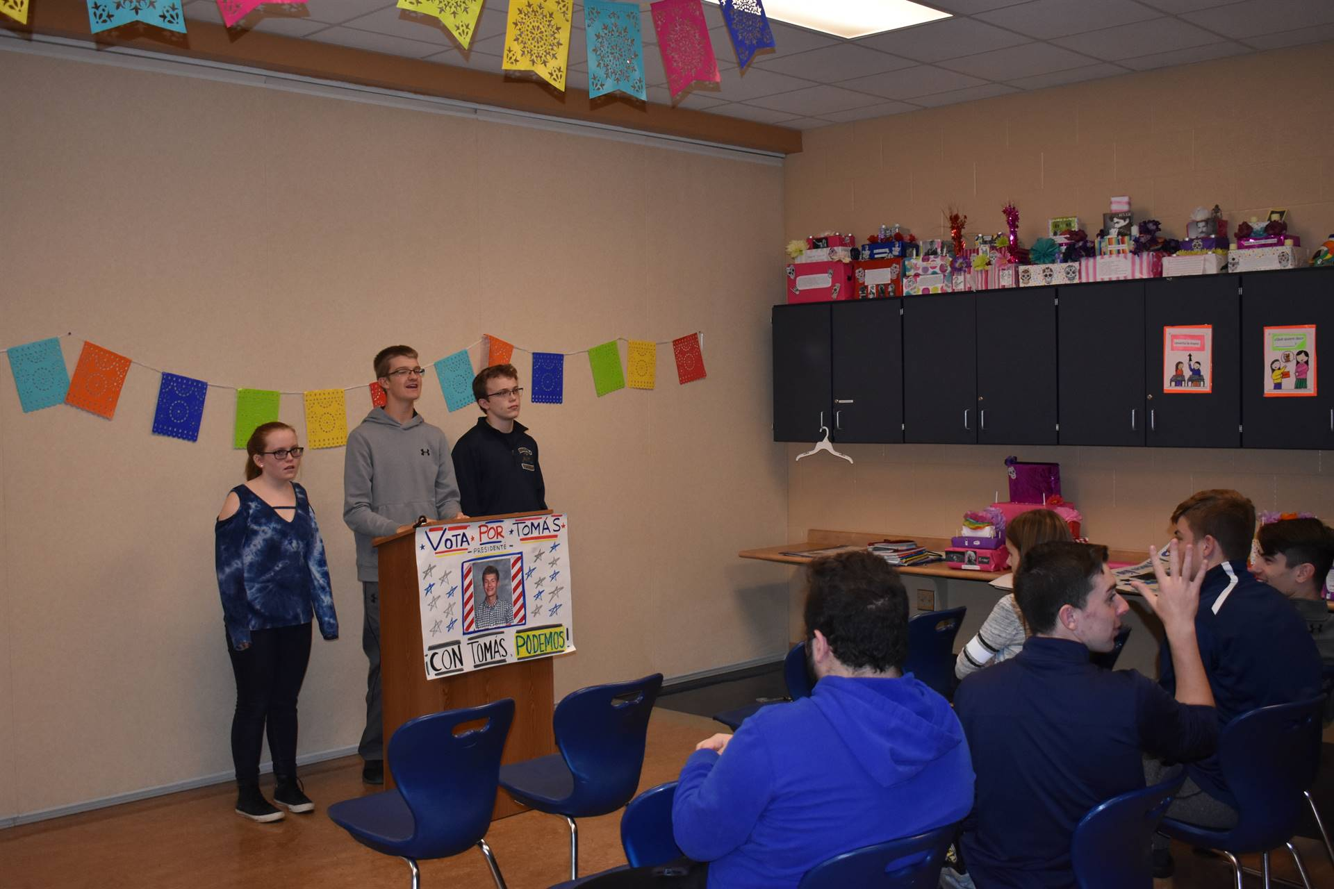 Brookfield High School students campaign for votes in Spanish class.