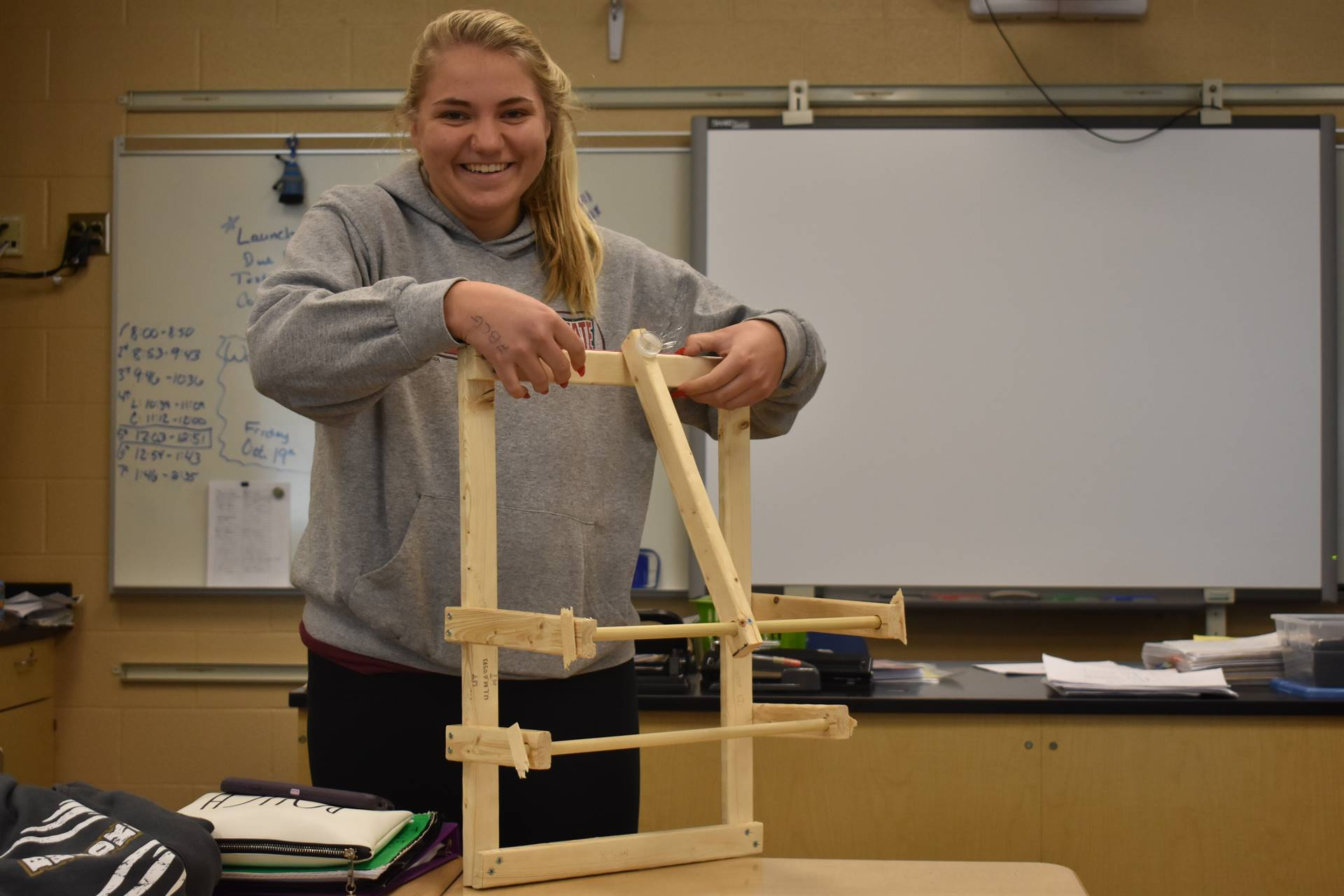 Students create catapults in physics class