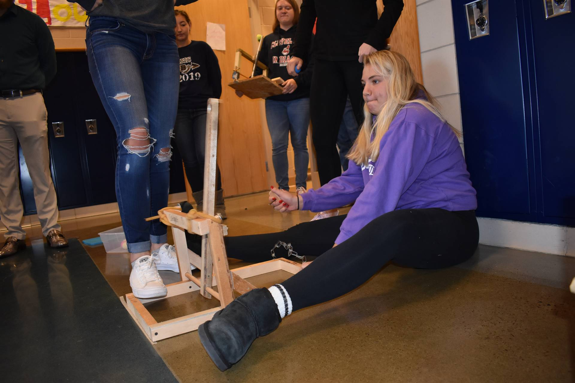 Students use their catapults in physics class.