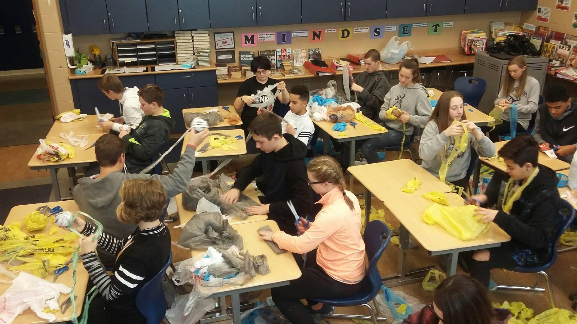 Mrs. Horn's 8th Grade ELA creating Sleeping Bags as part of their Homeless Initiative.