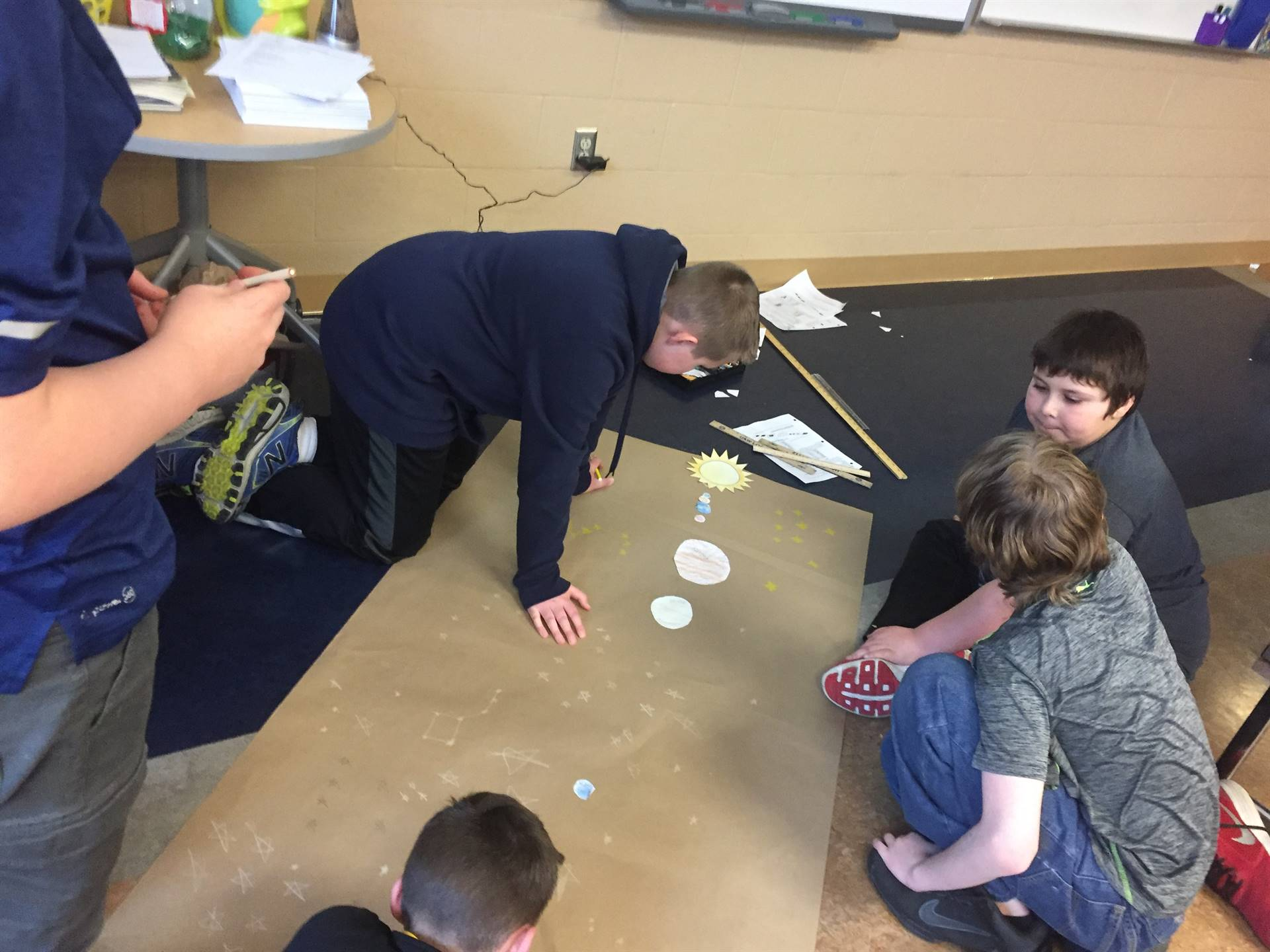 Mrs. Pirigyi's 5th Grade Science Classes designing scale models of the solar system.
