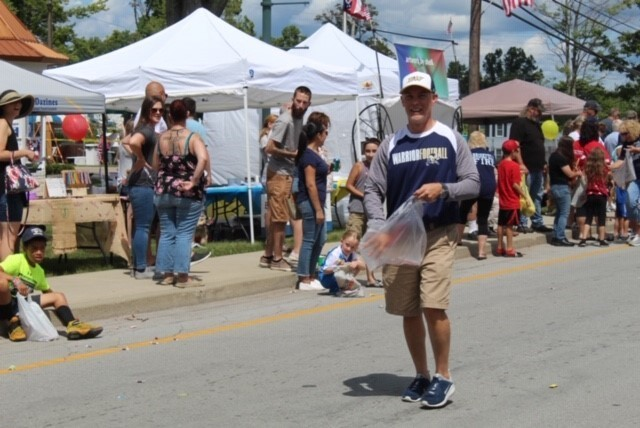 District Superintendent handing out candy during the Summer Fest Parade